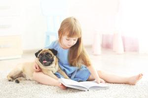 girl reading on carpet