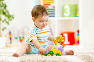 toddle playing on carpet